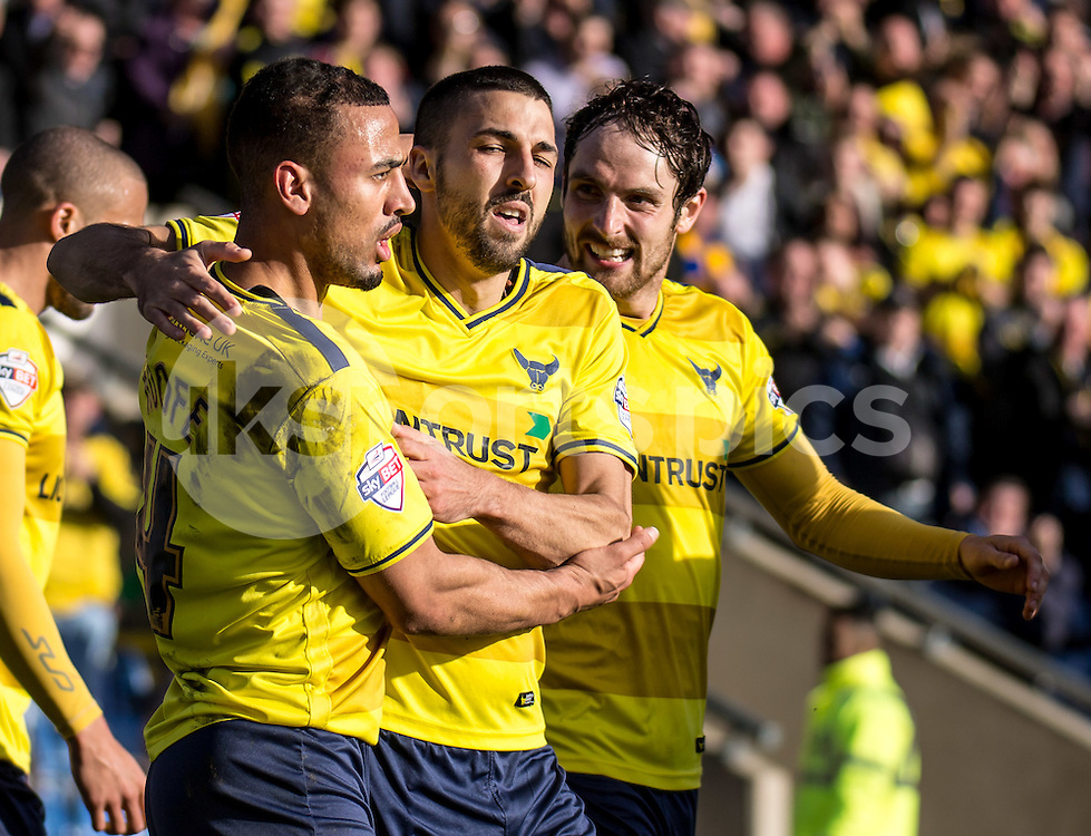 Liam Sercombe (centre) of Oxford United celebrates his goal with Kemar Roofe (left) and Danny Hylton (right) during the Sky Bet League 2 match between Oxford United and Stevenage at the Kassam Stadium, Oxford, England on the 25th March 2016. Photo by Liam McAvoy.