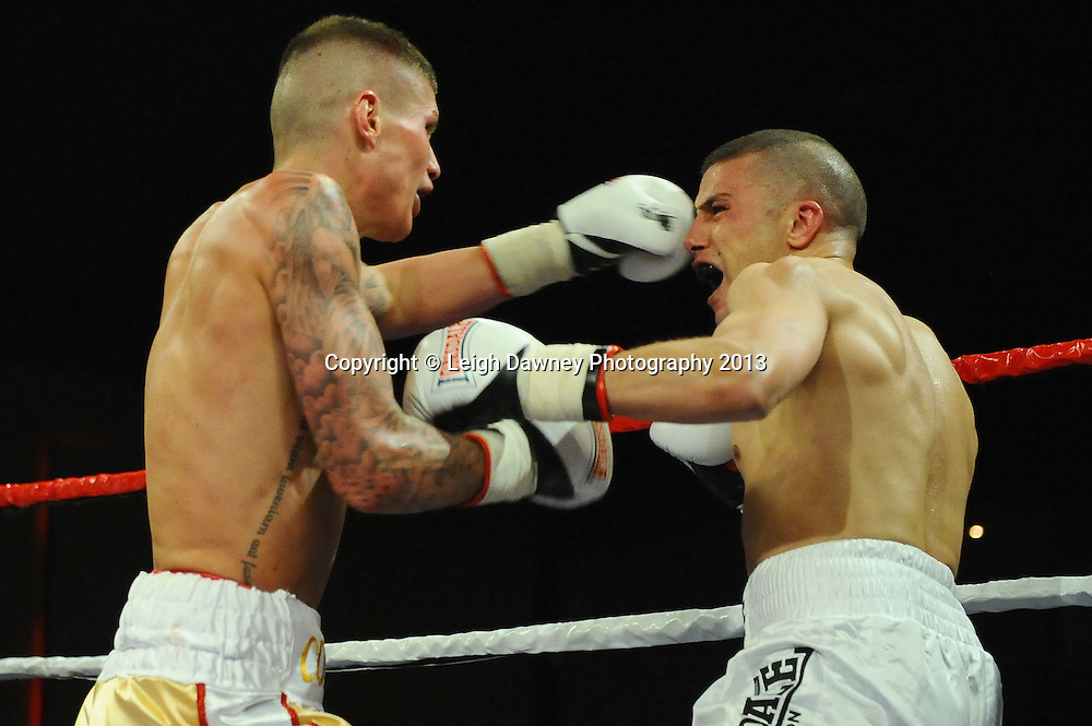 Peter Cope (gold shorts) defeats David Lake in a 6x3 Super Featherweight contest at Rainton Meadows Arena, Houghton Le Spring, Tyne & Wear, UK. 15th February 2013. Frank Maloney Promotions. © Leigh Dawney 2013