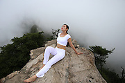 LUOYANG, CHINA - JULY 18: (CHINA OUT) <br /> <br /> Yoga On 2,000-meter High Precipice <br /> <br />  yoga on a 2,000-meter high precipice on Laojun Mountain, main peak of Funiu Mountain, during Laojun Mountain Camping Festival on July 18, 2015 in Luoyang, Henan Province of China. <br /> ©Exclusivepix Media