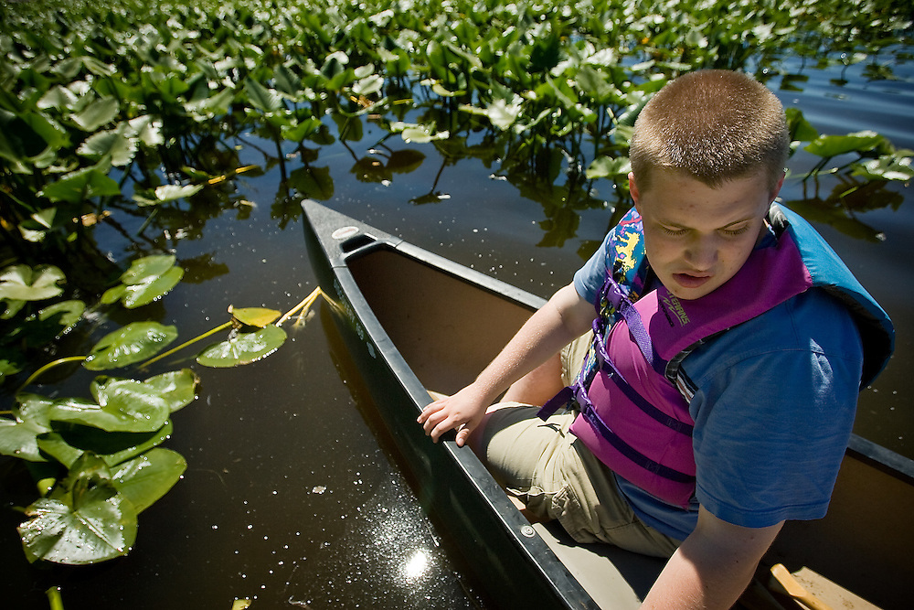 JEROME A. POLLOS/Press..Kevin Grafe looks back at a dock on Hauser Lake while deciding whether or not he wanted to participate in a canoe trip Monday during a Special Needs Recreation-event held at Hauser Lake.