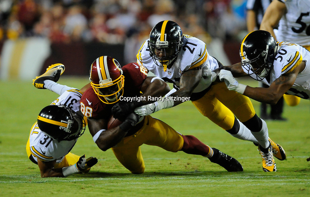 12 September 2016:  The Steelers Ross Cockrell (31), Robert Golden (21), and Ryan Shazier (50) tackle Redskins WR Pierre Garcon (88). The Pittsburgh Steelers defeated the Washington Redskins 38-16 on Monday Night Football at FedEx Field in Landover, MD. (Photo by Randy Litzinger/Icon Sportswire)