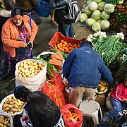 Fresh produce stall at the market. Chichicastenango is an indigenous Maya town in the Guatemalan highlands about 90 miles northwest of Guatemala City and at an elevation of nearly 6,500 feet. It is most famous for its markets on Sundays and Thursdays.