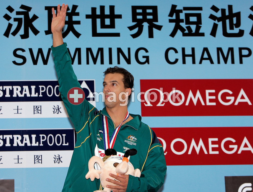 Matthew WELSH of Australia wins the gold medal in the men's 100m Backstroke final during day two of the 8th FINA World Swimming Championships (25m) held at Qi Zhong Stadium April 6th, 2006 in Shanghai, China. (Photo by Patrick B. Kraemer / MAGICPBK)