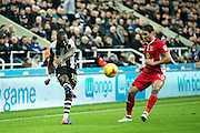 Newcastle United defender Chancel Mbemba (#18) crosses the ball ahead of the challenge from Blackburn Rovers midfielder Ben Marshall (#10) during the EFL Sky Bet Championship match between Newcastle United and Blackburn Rovers at St. James's Park, Newcastle, England on 26 November 2016. Photo by Craig Doyle.