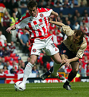 Photo Aidan Ellis.<br />Arsenal v Sheffield United (FA Cup Semi Final) <br />Old Trafford. 13/04/2003.<br />Sheffield's Michael Tonge and Arsenal's Freddie ljunberg