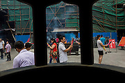 People pray at Chenghuang Miao or City God Temple in Yu Yuan Gardens bazaar Shanghai, China