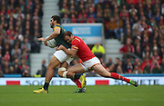 South Africa's Damian De Allende  getting tackled by Wales Jamie Robertsduring the Rugby World Cup Quarter Final match between South Africa and Wales at Twickenham, Richmond, United Kingdom on 17 October 2015. Photo by Matthew Redman.