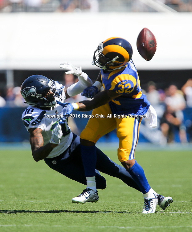 Seattle Seahawks wide receiver Paul Richardson (10) can't hold on to a pass intended for him as Los Angeles Rams cornerback Troy Hill (32) puts pressure on him during a NFL football game, Sunday, Sept. 18, 2016, in Los Angeles. The Rams won 9-3. (Photo by Ringo Chiu/PHOTOFORMULA.com)<br /> <br /> Usage Notes: This content is intended for editorial use only. For other uses, additional clearances may be required.