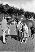 """08/08/1962<br /> 08/08/1962<br /> 08 August 1962 <br /> Dublin Horse show at the RDS, Ballsbridge, Dublin, Wednesday. Image shows John, Patrick and Mary O'Driscoll of Belvedere Stud, Donaghadee, Co. Down with her mothers 3 year old gelding """"Hypur"""", winner of the Anthony Maude Cup at RDS Show."""