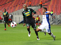 Wandisile Letlabika of Bloemfontein Celtic (L) and Buyani Sali of Chippa United during the 2016 Premier Soccer League match between Chippa United and Bleomfontein Celtic held at the Nelson Mandela Bay Stadium in Port Elizabeth, South Africa on the 25th October 2016<br />