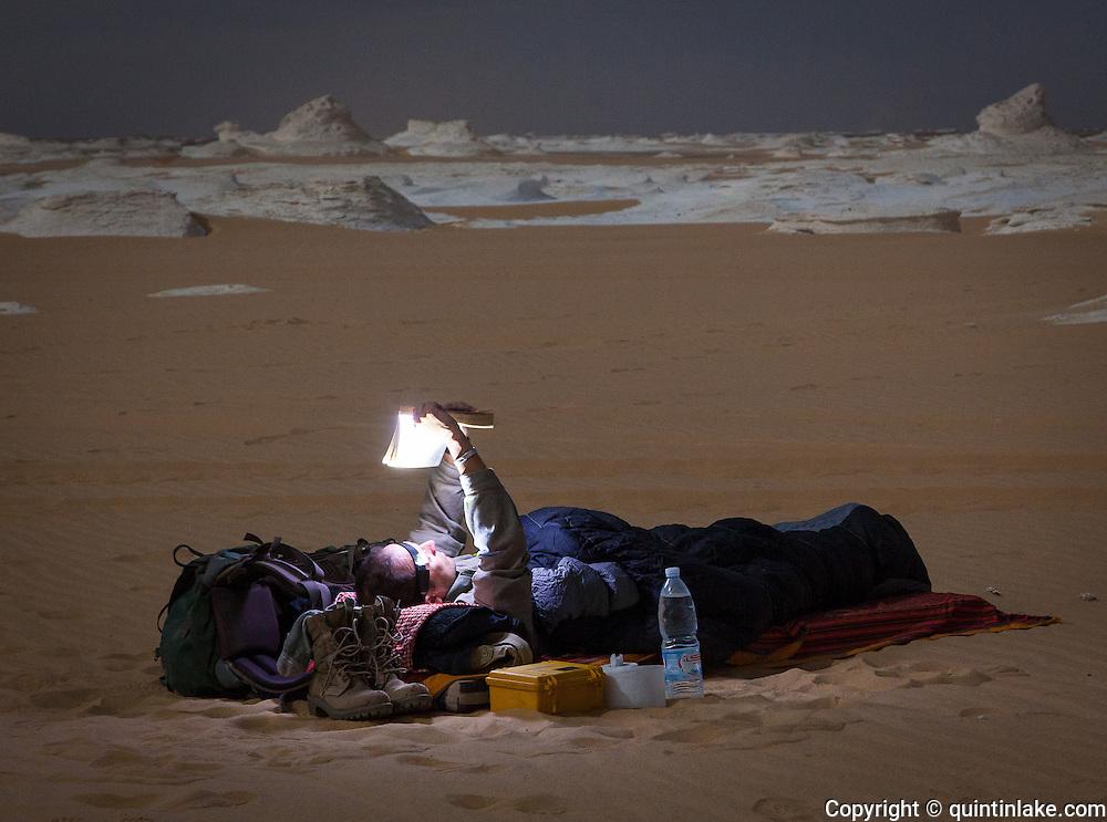 Sam McConnell prepares for a night under the stars, White Desert, Egypt