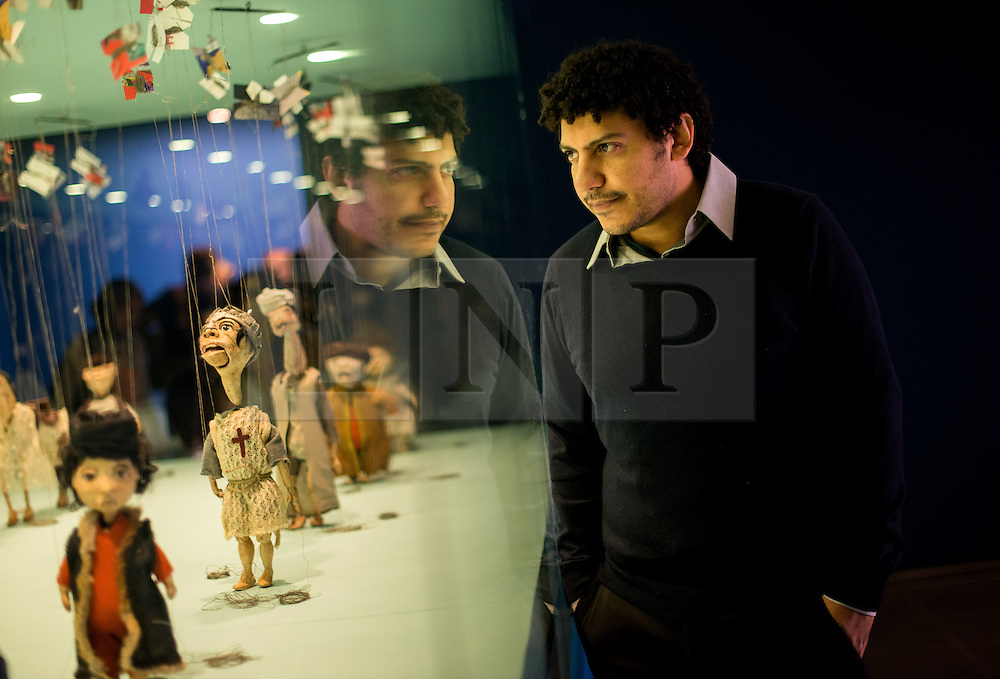 © Licensed to London News Pictures.27/11/2013. London, UK.Artist Wael Shawky poses for photographers with his artwork at Serpentine Gallery. The gallery launches its winter exhibitions that present Jake and Dinos Chapman: Come and See and Egyptian artist, Wael Shawky artworks.Photo credit : Peter Kollanyi/LNP