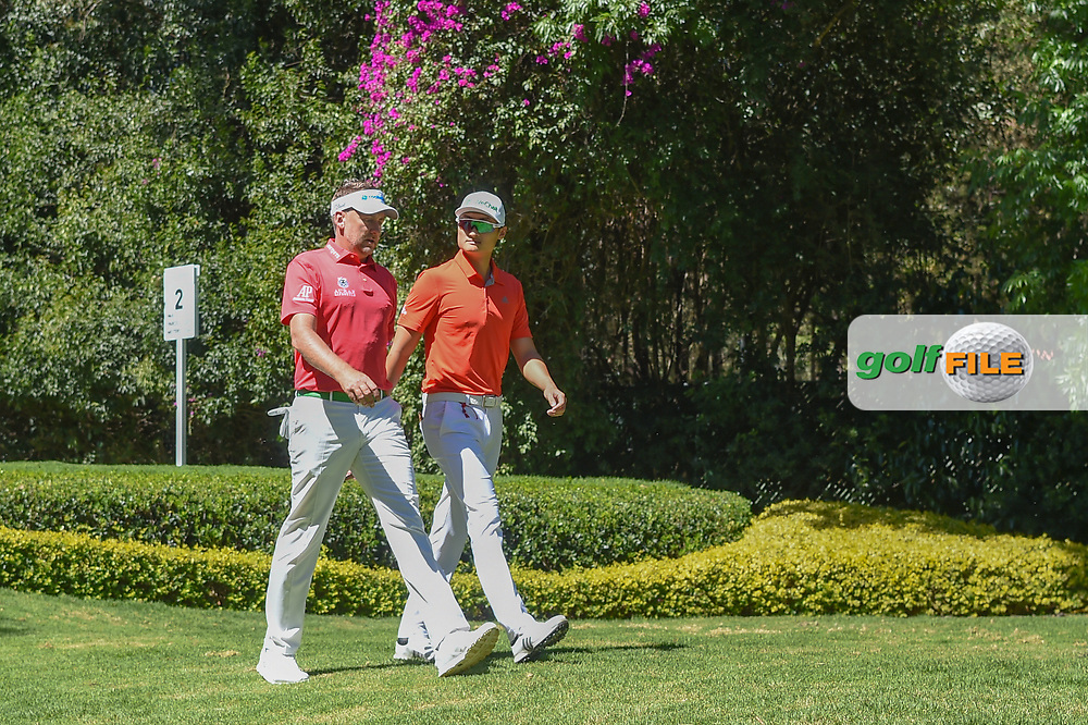 Ian Poulter (GBR) and HaoTong Li (CHN) head down 2 during round 1 of the World Golf Championships, Mexico, Club De Golf Chapultepec, Mexico City, Mexico. 2/21/2019.<br /> Picture: Golffile   Ken Murray<br /> <br /> <br /> All photo usage must carry mandatory copyright credit (© Golffile   Ken Murray)