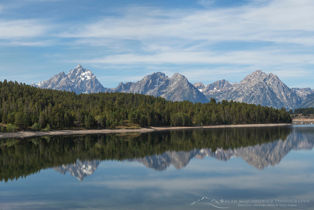 Teton Range reflected in still waters of Jackson Lake, Grand Teton National Park Wyoming