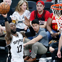 01 May 2017: San Antonio Spurs guard Jonathon Simmons (17) takes a jump shot during the Houston Rockets 126-99 victory over the San Antonio Spurs, in game 1 of the Western Conference Semi Finals, at the AT&T Center, San Antonio, Texas, USA.