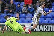 James Norwood (Tranmere Rovers) is challenged for the ball on the edge of the box by Luke Foster (c) (Southport) and goes down. The referee deems this a dive and issues the Trenmere player a yellow card during the Vanarama National League match between Tranmere Rovers and Southport at Prenton Park, Birkenhead, England on 6 February 2016. Photo by Mark P Doherty.
