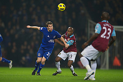 LONDON, ENGLAND - Tuesday, December 28, 2010: Everton's Seamus Coleman and West Ham United's Luis Boa Morte during the Premiership match at Upton Park. (Pic by: David Rawcliffe/Propaganda)