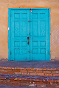 Turquoise blue doors of Old Town Emporium; Albuquerque, New Mexico.