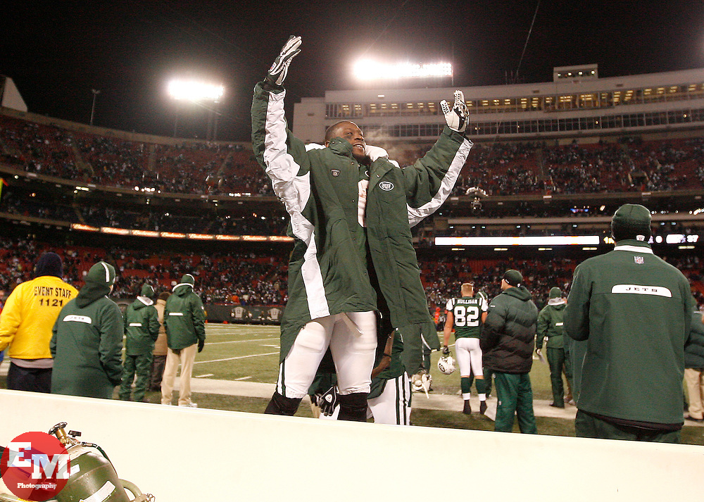 Jan 3, 2010; East Rutherford, NJ, USA; New York Jets running back Thomas Jones (20) celebrates with the crowd during the second half at Giants Stadium. The Jets clinched a playoff spot with a 37-0 win over the Bengals.