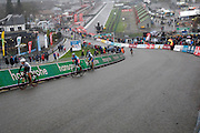 Belgium, Sunday 13th December 2015: Riders ascend the steep Raidillon corner part of the Spa Francorchamps motor racing circuit during the women's race at the Hansgrohe Superprestige cyclocross 2015 event.<br />