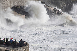 © London News Pictures. 16/10/2017. Portleven, UK. Member son the public watch huge waves batter the coastline at Portleven in Cornwall as the remnants of storm system Ophelia reaches the UK. The Met Office has issued an Amber weather warning, with a good chance that power cuts may occur, with the potential to affect other services, such as mobile phone coverage.. Photo credit: Mark Hemsworth/LNP