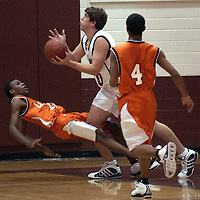 Woodlands' #50 Andy Maish shoots for two as La Port's #10 Kevin Perkins falls during the 73rd Annual CCISD Boys Basketball Classic, 12/01/05