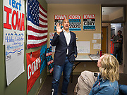 19 DECEMBER 2019 - URBANDALE, IOWA: Volunteer DAWN HALSTEAD, front right, listens to US Senator CORY BOOKER (D-NJ) talk to volunteers at his presidential campaign headquarters in Urbandale, a suburb of Des Moines. Sen. Booker, who did not qualify for the December 19 debate in Los Angeles, campaigned in the Des Moines area Thursday and visited the phone bank at his Iowa campaign headquarters. Iowa traditionally holds the first event of the presidential election cycle. The Iowa caucuses at Feb. 3, 2020.             PHOTO BY JACK KURTZ