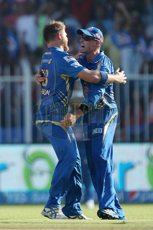 Corey Anderson of the Mumbai Indians  and Michael Hussey of the Mumbai Indians celebrate the wicket of Quinton de Kock of the Delhi Daredevils during match 16 of the Pepsi Indian Premier League 2014 between the Delhi Daredevils and the Mumbai Indians held at the Sharjah Cricket Stadium, Sharjah, United Arab Emirates on the 27th April 2014<br /> <br /> Photo by Ron Gaunt / IPL / SPORTZPICS