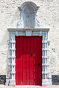 Traditional Belgian architecture red door and doorway portico in Bruges - Brugge - Belgium