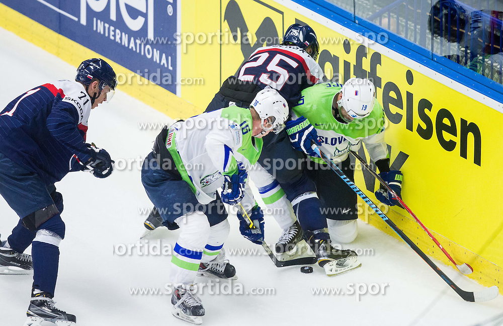 Marek Viedensky of Slovakia vs Ales Music of Slovenia and Ziga Pance of Slovenia during Ice Hockey match between Slovakia and Slovenia at Day 5 in Group B of 2015 IIHF World Championship, on May 5, 2015 in CEZ Arena, Ostrava, Czech Republic. Photo by Vid Ponikvar / Sportida