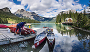 Rent canoes for paddling on pristine waters at Emerald Lake Lodge in Yoho National Park, British Columbia, Canada. Yoho is one of several Canadian Rocky Mountains parks which comprise a spectacular World Heritage Area listed by UNESCO in 1984. The panorama was stitched from 4 overlapping images.
