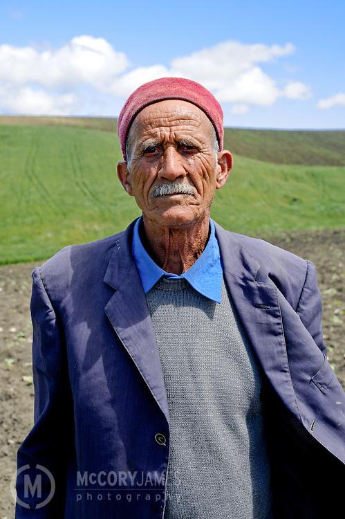An elderly man takes a break from working in the fields of Tunisia