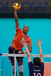 09-08-2019 NED: FIVB Tokyo Volleyball Qualification 2019 / Netherlands, - Korea, Rotterdam<br /> First match pool B in hall Ahoy between Netherlands - Korea for one Olympic ticket / Nimir Abdelaziz #14 of Netherlands