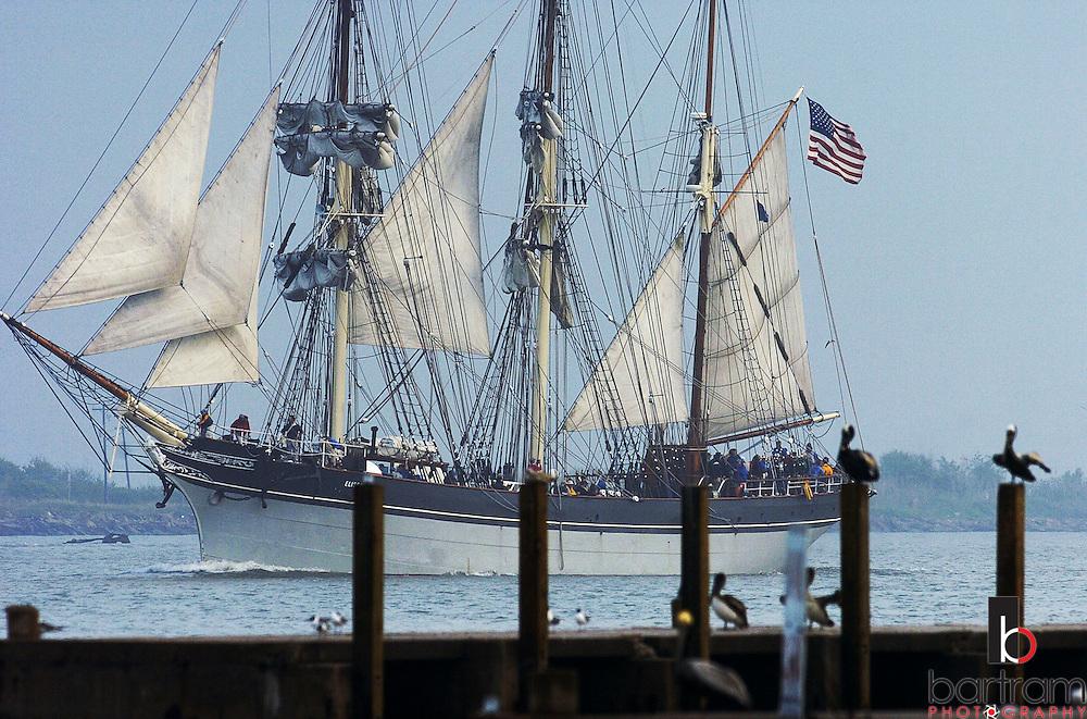 (PHOTO BY KEVIN BARTRAM).The Elissa sails past the Galveston Yacht Basin on Wednesday, April 6, 2005 as it leads the Spanish Navy schooner Juan Sebastian de Elcano into the Port of Galveston, Texas.