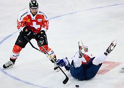 Tomaz Razingar of Slovenia vs Goran Bezina of Switzerland during friendly ice-hockey match between Slovenia and Switzerland, on December 14, 2011 at Hala Tivoli, Ljubljana, Slovenia. (Photo By Matic Klansek Velej / Sportida)