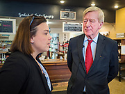 08 JANUARY 2020 - NEVADA, IOWA: Former Governor WILLIAM WELD (R-MA), right, talks to KIMBERLY STEPHENS, from Nevada, IA, during a campaign stop at Farm Grounds, a coffee shop in Nevada. Weld, who was a two term Republican Governor of Massachusetts, is campaigning in Iowa in support of his primary challenge of Republican incumbent President Donald Trump.       PHOTO BY JACK KURTZ