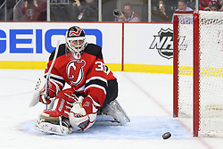 Jan 17; Newark, NJ, USA; New Jersey Devils goalie Martin Brodeur (30) watches the puck hit the post during the first period of their game against the Winnipeg Jets at the Prudential Center.