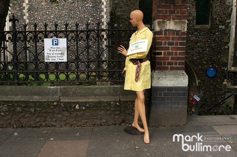 Mannequin dressed in yellow check dress in Norwich, Norfolk