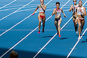 (R) Iga Baumgart from Poland competes in women's relay 4x400 meters qualification during the 14th IAAF World Athletics Championships at the Luzhniki stadium in Moscow on August 16, 2013.<br /> <br /> Russian Federation, Moscow, August 16, 2013<br /> <br /> Picture also available in RAW (NEF) or TIFF format on special request.<br /> <br /> For editorial use only. Any commercial or promotional use requires permission.<br /> <br /> Mandatory credit:<br /> Photo by &copy; Adam Nurkiewicz / Mediasport