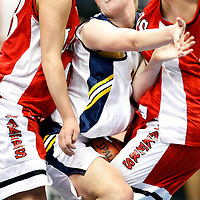 Detroit Lakes' Hallie Hoganson, left, and Alic Branden stop Totino-Grace's Jessica Meyer in her tracks Wednesday afternoon at the Target Center during the 2007 State Girl's Basketball Tournament in Minneapolis, Minn.