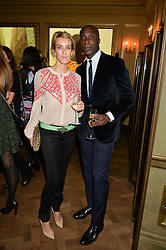 SARAH WOODHEAD and OZWALD BOATENG at the Sindika Dokolo Art Foundation Dinner held at The Cafe Royal, Regent Street, London on 18th October 2014.