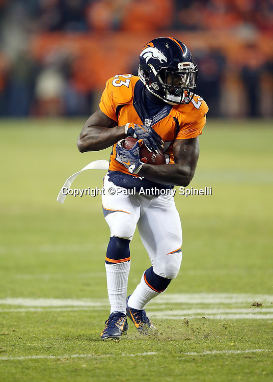 Denver Broncos running back Ronnie Hillman (23) runs with the ball after catching a pass during the 2015 NFL week 16 regular season football game against the Cincinnati Bengals on Monday, Dec. 28, 2015 in Denver. The Broncos won the game in overtime 20-17. (©Paul Anthony Spinelli)