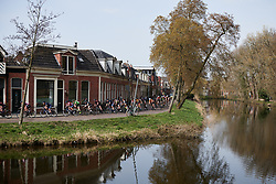 The peloton speed along the waterside at Healthy Ageing Tour 2018 - Stage 5, a 94.3 km road race in Groningen on April 8, 2018. Photo by Sean Robinson/Velofocus.com