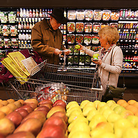 Adam Robison | BUY AT PHOTOS.DJOURNAL.COM<br /> Betty Campbell and her husband Gale, of New Albany, pick out a couple of apples from the produce department at the newly remodeled and renovated Kroger on Main Street in Tupelo Wednesday morning.