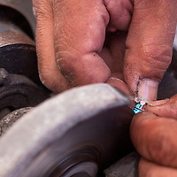 052413       Cable Hoover<br /> <br /> Jewelry maker Raylan Edaakie uses a grinder to create the features of the popular sun face design for an inlay demonstration during the Annual Zuni Festival of Arts and Culture at the Museum of Northern Arizona in Flagstaff, Ariz. Saturday.
