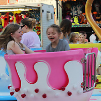 Lakin Williams and Jaylee Presley, both 7, of Amory spin around on the tea cup ride at the carnival.