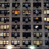 Gloomy apartment building at night. Manhattan, New York City.