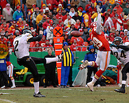 Kansas City Chief's Bernard Pollard (49) blocks Jacksonville punter Chris Hanson's (2) first half punt.  Pollard would recover the ball in the end zone for the Chiefs first touchdown at Arrowhead Stadium in Kansas City, Missouri, December 31, 2006.  The Chiefs lead the Jaguars at halftime 21-10.<br />