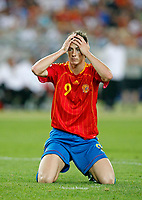 Photo: Glyn Thomas.<br />Spain v Tunisia. FIFA World Cup 2006. 19/06/2006.<br /> Spain's Fernando Torres with his head in his hands.