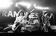 PICTURE BY HOWARD BARLOW..ARTIST - THE RAMONES  -  JOHNNY RAMONE (guitar) &.              JOEY RAMONE.VENUE   - MANCHESTER Apollo.DATE    - 21 DEC 1977